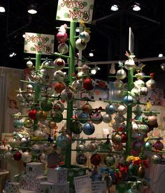 Ornament display tree.  DIY?  Use a closet rod and smaller dowels.  I'd make it so I can take the dowels out for storage.