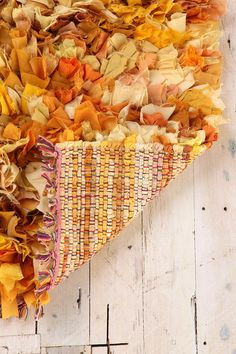 UrbanOutfitters.com > Mixed Media Shag Rug - no instructions, but this could easily be done with old shirts and fabric scraps to make a great bathroom rug!