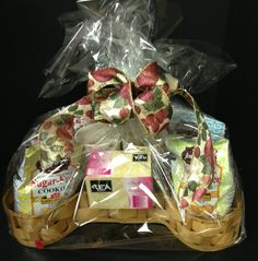 Item #19 Tea time basket. Includes: 2 mugs, box of tea bags, sugar free cookies. Makes for a great afternoon tea time with a friend!