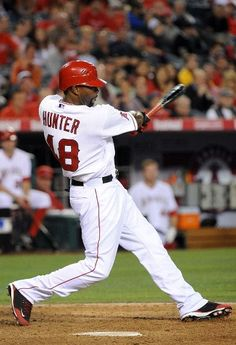 Game #69 6/19/12: Torii Hunter #48 of the Los Angeles Angels of Anaheim hits a RBI single in the eighth inning against the San Francisco Giants at Angel Stadium of Anaheim on June 19, 2012 in Anaheim, California. (Photo by Lisa Blumenfeld/Getty Images)