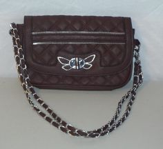 Very unique butterfly clasp and zipper accents! Zipper Closure and Then Turn Knob Closure. Bag Height: 6 inches (15.24 cm) Bag Depth: 2 inches (5.08 cm)