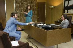Richie Dimaso (Bradley Cooper, left) prepares to bust Sydney Prosser (Amy Adams, center) and Irving Rosenfeld (Christian Bale) in Columbia Pictures' AMERICAN HUSTLE. Photo by:  Francois Duhamel
