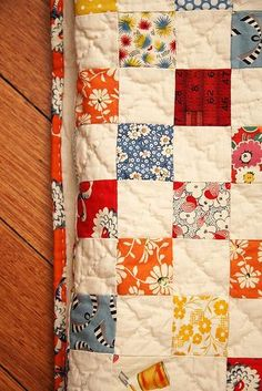 Simple but lovely with vintage-ish prints. nine patch with binding by penelope waits, via Flickr