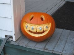 Pumpkin with braces  :-) ---- This is awesome! Gotta remember this one for next year!!!