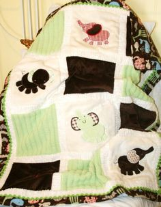 "Personalized Elephant Appliqued Minky Blanket "" Adorable Elephants"". $85.00, via Etsy."