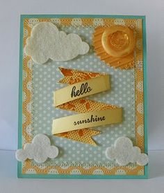 hello sunshine...love the double sided paper used for the banner and the way it's attached....felt clouds are adorable.