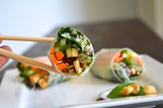 Vietnamese Rice Paper Roll Appetizers with Roasted Tofu Sticks, a minty, pineapple in-roll sauce and peanuts for that extra crunch.