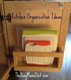 kitchen organization - cutting boards inside cupboard door.