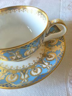 Gold and blue tea cup and saucer