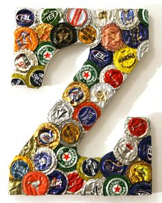 a giant letter made with some left over beer caps.