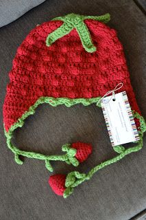 Strawberry Crochet Hat:  Free pattern.  Seems to be a pretty simple stitch,and I just love the ties, omg how adorable and clever!