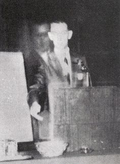 "In 1968, the brother of Robert A.  Ferguson appeared beside him during  a speech at a Spiritualist convention.    ""Walter"" was killed during World War II.    What is fascinating about this  photograph is that it is a Polaroid and  incapable of being a double-exposure.   And if it were a double-exposure, the  difference in contrast would not be  evident."