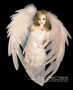 Angelic WHITE GABRIEL eProductSales Feather Angel Wings for MINIATURE COLLECTOR DOLLS 70cm sd13 BJD and other Fashion dolls. $116,00, via Etsy.