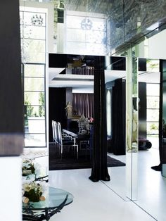 20 Must-Know Terms for Buying the Perfect Mirror | DomaineHome.com // Mirrored entryway.