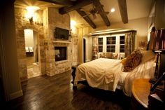 Love this stone FP with the wood floor.