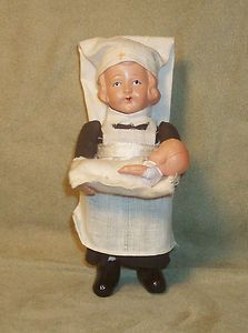 Vintage Celluloid Wind Up Nurse with Baby
