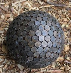 Pennies repel snails and slugs and make hydrangeas blue.  These pennies are glued on a thrift store bowling ball.