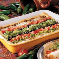 Burrito Bake - Quick and easy Taste of Home recipe your family will love. Uses crescent rolls, ground beef, refried beans, cheese, taco seasoning and toppings. Wonderful addition to your casserole collection.
