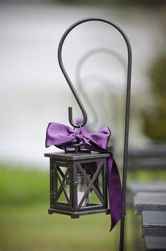Mini black lanterns hung on shepard's hooks