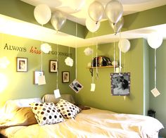 pictures hanging from balloons
