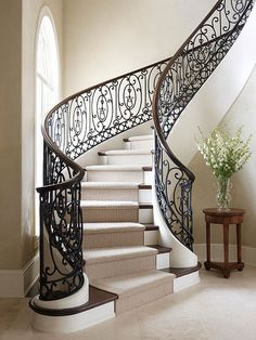 Sculptural Staircase - The most magnificent stairways often look more like works of art, such as this serpentine piece that coils as it rises. Building these stairs combined the skills of various artisans who work with wood, metal, and drywall.