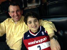John Stark and his 9-year-old son, Jacob Stark, at a Washington Wizards game against the Oklahoma Thunder. John is wearing a Panerai Luminor Marina 1950 3 Days Automatic (PAM 359).