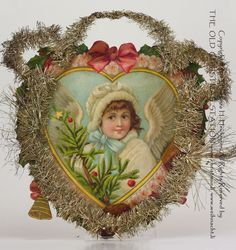 THE OLD CHRISTMAS STATION - Angel in a Heart Shape :: Tinsel and Scrap Ornament :: Tinsel and Scrao :: Satchel :: Toys :: Tree:: Belsnickle :: Belsnickel :: old christmas ornament :: Dresden Paper :: antique :: German Christmas Decorations :: figural glass :: Sebnitz :: old Cotton Ornaments :: Heubach :: Kugels :: vintage :: Christmas Rarities