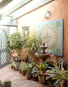 south western potted plant garden, wood gate, brick, stucco walls, house beautiful, courtyard