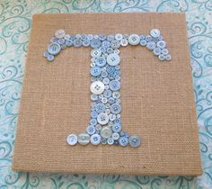 "I love this 12""x12"" ""T"" for Talia's room - $90 (each new & vintage button is hand sewn into place w/ strong embroidery thread. Button monogram is then secured onto burlap. Set it by a lamp or window so the buttons can reflect the light! Sizes from $60 (8""x10"") - $150 (16""x20"") button monogram, button art, nursery wall art, button letters on canvas, baby boys, babies nursery, babi boy, baby boy nurseries, letter art"