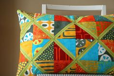 A stunning patchwork pillow created by Amanda of Crazy Mom Quilts.  I love the unexpected bright green sashing and the hand quilting done with perle cotton.  This is a wonderful pillow!