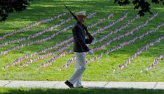 Norwich University senior Kyle Rau from Oak Creek, Wi., marches during a vigil in memory of the victims of Sept. 11 in Northfield, Vt. Norwich students planted 2,977 American flags on the college's parade ground and are holding a vigil from midnight to midnight in remembrance of the Sept. 11 attacks. (Toby Talbot/Associated Press)