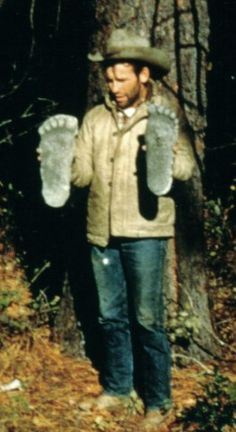 Roger Patterson holds casts at Bluff Creek following the incident.