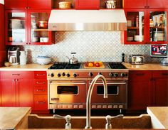 Red Kitchen design. Love the #backsplash!