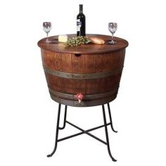 "Repurposed oak wine barrel bistro table and cooler. Product: Bistro table and cooler    Construction Material: Wine barrel oak, steel, PVC liner and pine wood    Color: Brown   Features:   Lift top for interior cooler  Water tight liner  Drain faucet     Made in the USA          Dimensions: 38"" H x 29"" Diameter"