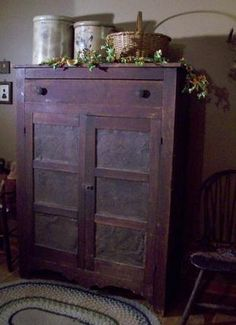 Antique wooden pie safe with crocks and basket - nice display!