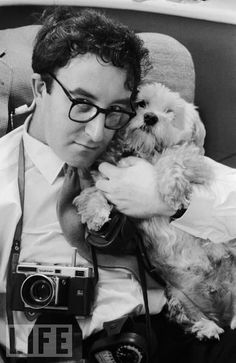 Comic actor Peter Sellers (1925 - 1980) cuddles a small dog at his home in Muswell Hill, London, 17th April 1956. Photo by John Chillingworth/Picture Post/Getty Images