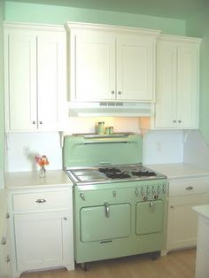 retro kitchen....... don't really think the cabinets flow but i love the white with green