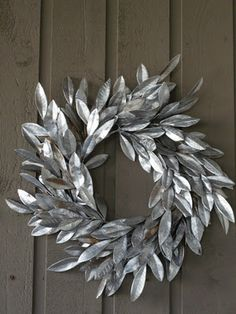 spray painted plastic leaf wreath. good idea! could do any color and then add some fun stuff like a monogram or berries or something...