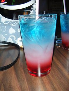 "Bomb Pop Drink ~   2 oz Bacardi® Razz rum  2 oz lemonade  2 oz Blue Curacao liqueur (These look like those ""Rocket"" popsicles they used to have at the airshow when I was little!!)"