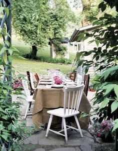 Patio Dining:     Set up your dining room table on the patio for a backyard feast with friends. A tablecloth and flowers dress up the table, while mismatched chairs keep it from feeling too formal.