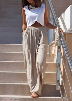 slouchy pants and a white crop top..