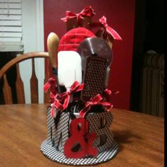 """""""Cake"""" with kitchen towels and kitchen gadgets, homemade Mod-Podge on the letters. Perfect for a wedding shower!  This is cute!"""