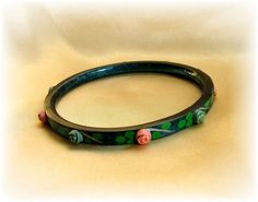 Vintage celluloid bangle in dark blue with applied rose buds ~  $82