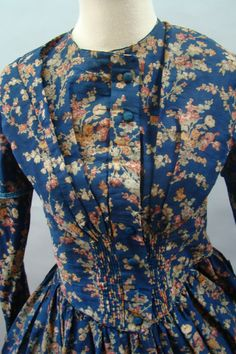 "Pretty Print 1840's Dress for Study or Repair, wool barege, polished cotton lining, waist: 28""; bust: 31""; hand stitched, piping at neck, dropped shoulder & waist, five decorative threat covered buttons remaining, hook & eye closure; hem bound with self fabric, faced with blue material about 5"" up, pocked on right front side.Pretty Print 1840's Dress for Study or Repair Wool Gown 