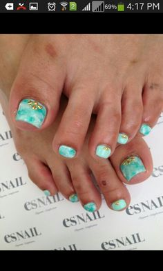 Pedicure: love this turquoise and white  tye-dye look (minus the jewels too, they just don't look right w/this design and color pattern) but man, those are some NASTY toes!!!! Gross- almost ruins this and I can barely look at this pedicure design!!!