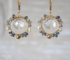 Rock crystal earrings in goldfilled with labradorite, iolite, pyrite and freshwater pearls! <3 Available at: www.facebook.com/ateliergabymarcos