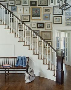 How much do you love that wall?  Such a great way to organize your favorite family prints...