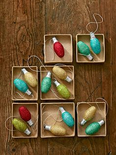 Sparkling Ornaments - Genius!  Just brush on glittering glue, roll the bulb in glitter, and let dry for 15 minutes. Then hot-glue a loop of metallic embroidery floss to the bulb's base.