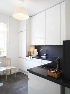 Glossy white kitchen, dark splash back