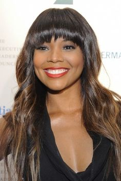A lot of women with round faces avoid bangs, but we think it's a great look if you do it right!